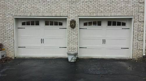 Steel carriage house stamped garage door with stockton windows